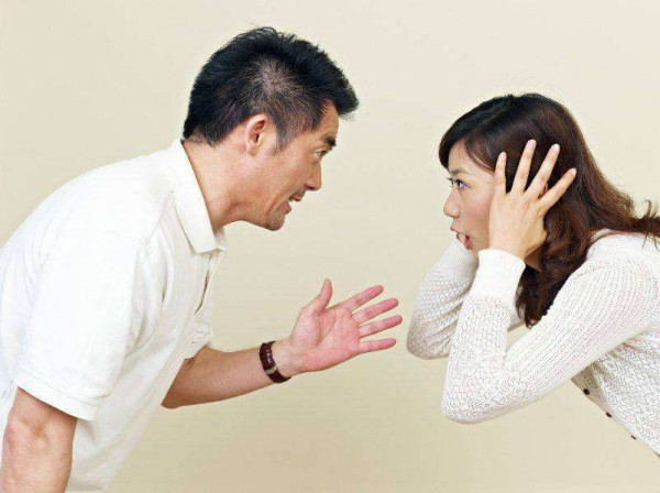 young asian couple having an argument.