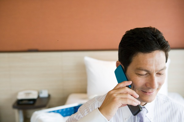Businessman making a phone call in hotel room