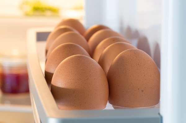 Open fridge filled with eggs