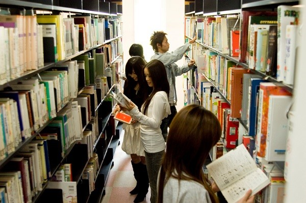 Japanese college student in library