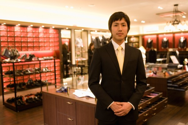 Male salesclerk at men's clothing counter