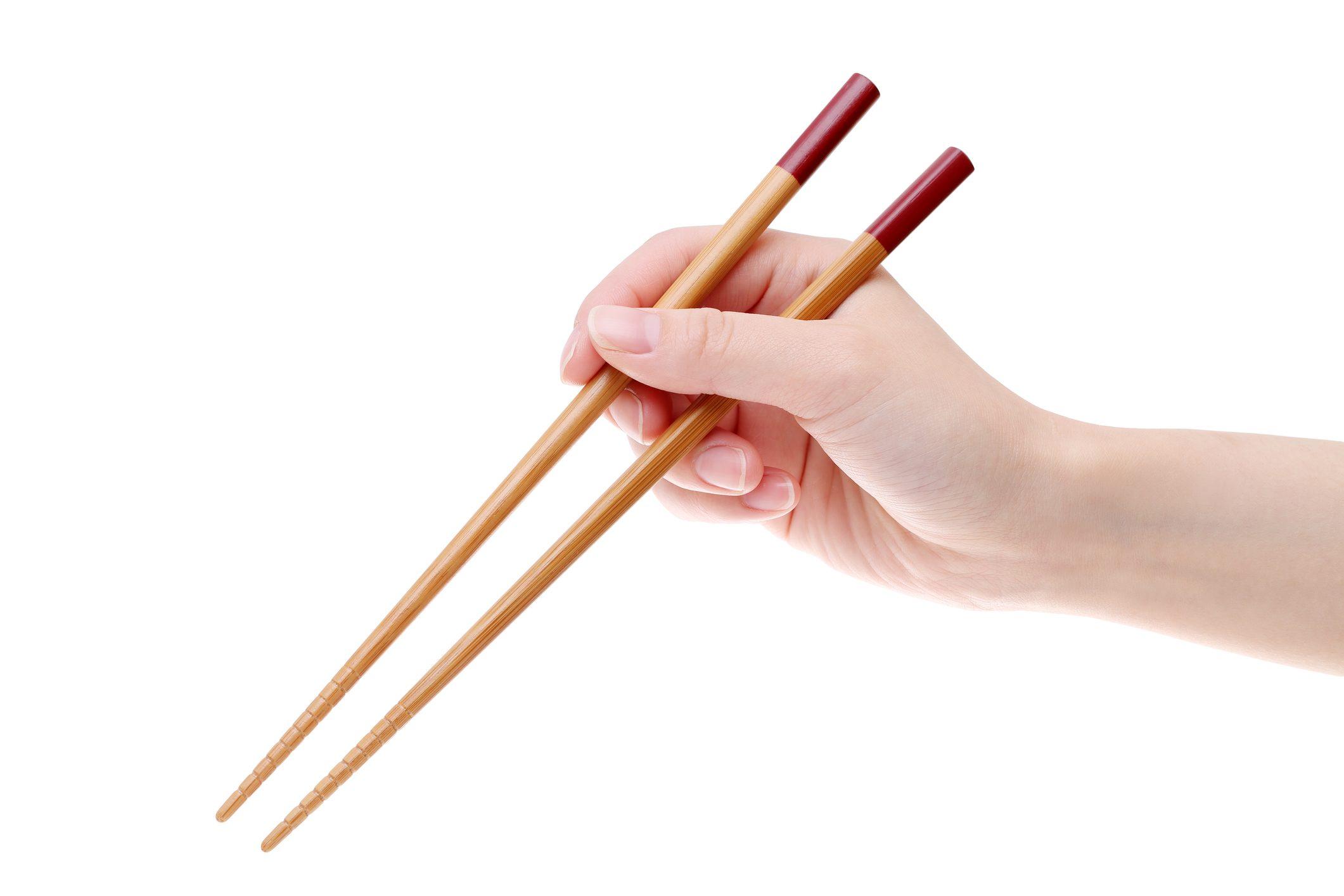 手持ち株の木の箸の写真素材